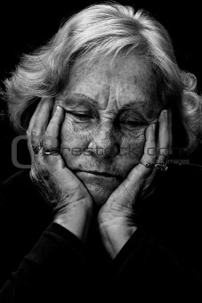 Black and white depressed senior woman