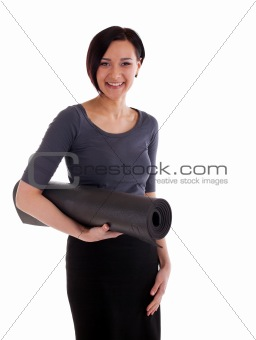 Yong woman with yoga rubber mat
