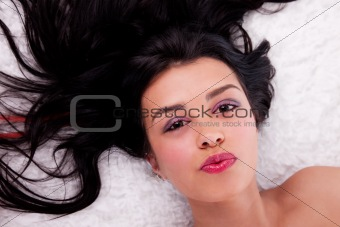 Beautiful woman lying,  studio shot