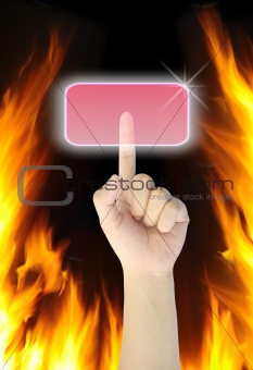 hand pressing button on fire background