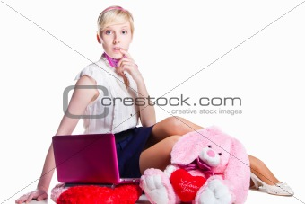 blond girl working with pink laptop on isolated white