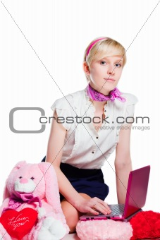 beautiful blond girl working with pink notebook on isolated white