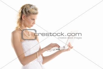 beautiful bride with laptop