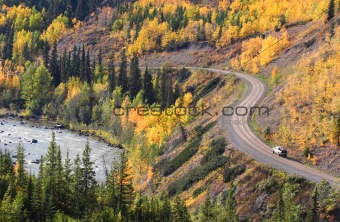 Autumn colored trees along mountain road in British Columbia