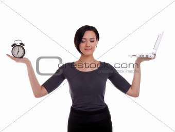 businesswoman balance with clock and laptop