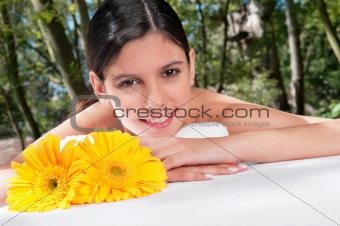 Beautiful young woman with flowers around