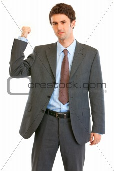 Angry modern businessman showing get out gesture