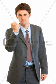 Angry modern businessman threaten with fist