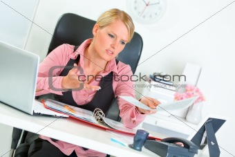 Sitting at office desk business woman dissatisfied with bad results of work