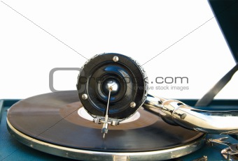 Antique old player (gramophone) isolated on a white background