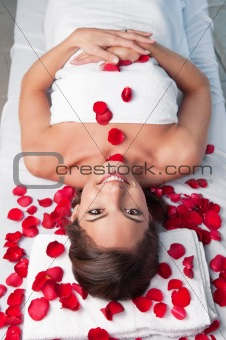 Smiling beautiful woman lying on a massage table