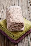 Fresh towels on a rustic wooden surface