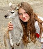 young girl hugging a kangaroo