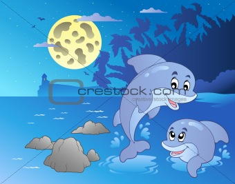 Night seascape with happy dolphins