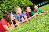 Teenage Female Friends Lying on Green at Park