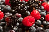 Mixed raspberries, blueberries and blackberries background