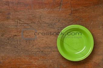 green bowl on grunge wood