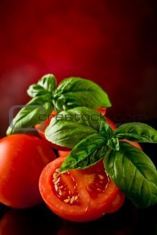Sliced Tomatoes with basil on glass table