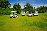 Four eco transporters on golf course 