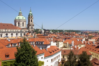 czech republic, prague - st. nicholas church at roofs of little quarter (mala strana)