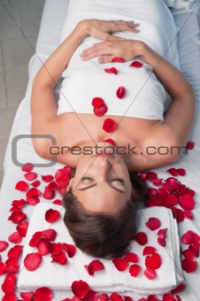 Beautiful relaxed woman lying on a massage table