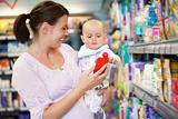 Mother Shopping with Baby in Supermarket