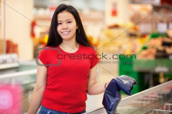 Portrait of smiling woman in store