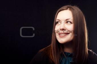 Smiling brunette on black