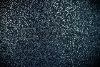 Abstract image of droplets of water condensation on metal