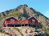 Two wooden red cottage on the mountain