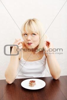 Beautiful woman eating cake.