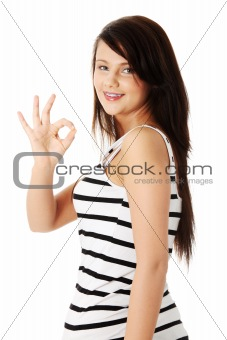 Beautiful young success woman giving perfect gesture