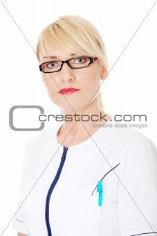 Mature female doctor or nurse