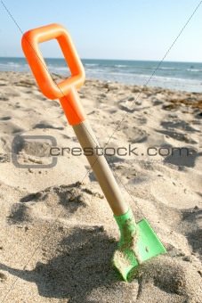 Beach shovel on sand