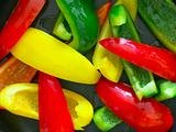 sliced bell peppers in frying pan