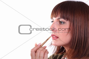 Young woman does make-up