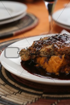 Grilled chicken breast, red wine sauce; close crop tall