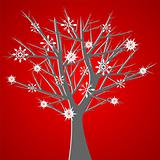 Tree over red with snow crystals
