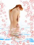 healthy redhead in blue water with flowers