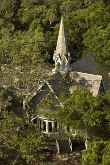 Church aerial in trees.