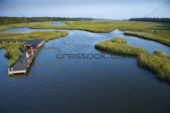 Boys on dock in marsh.