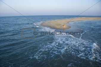 Aerial of couple on beach.