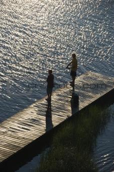 Boys fishing on dock.