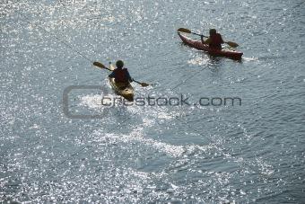 Boys in kayaks.