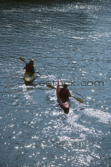 Two boys kayaking.