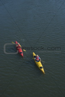Boys ocean kayaking.