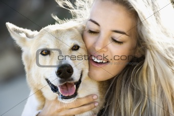 Woman petting dog.