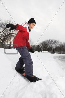 Boy snowboarding.