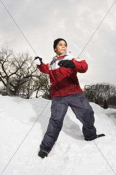 Boy throwing snowball.