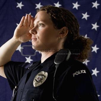 Policewoman saluting.